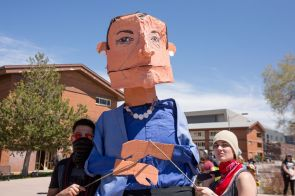 protesters carry an effigy of Northern Arizona University president Rita Cheng.